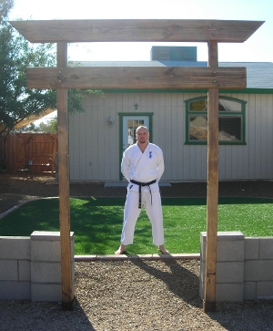 Sensei in front of his dojo